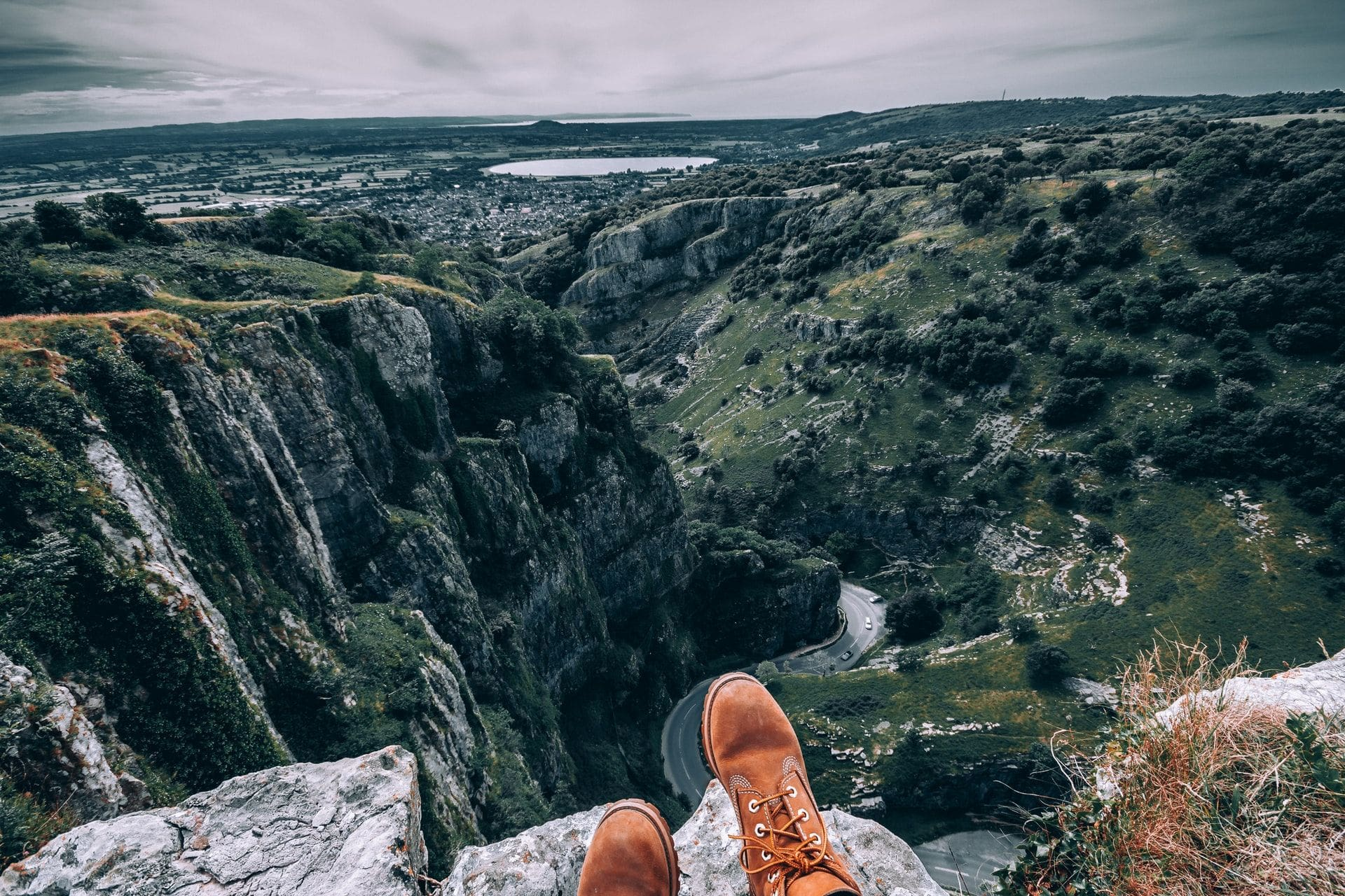 boots-sat-on-top-of-rock-above-winding-road-cheddar-gorge-somerset-day-trips-from-bristol