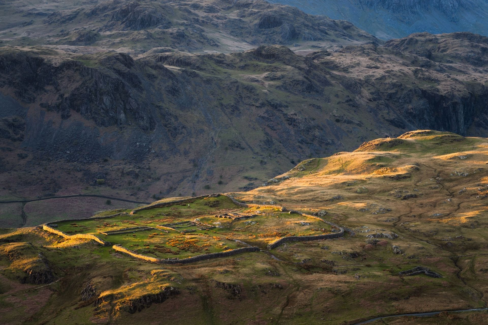 hardknott-pass-road-in-lake-district-england-surrounded-by-mountains