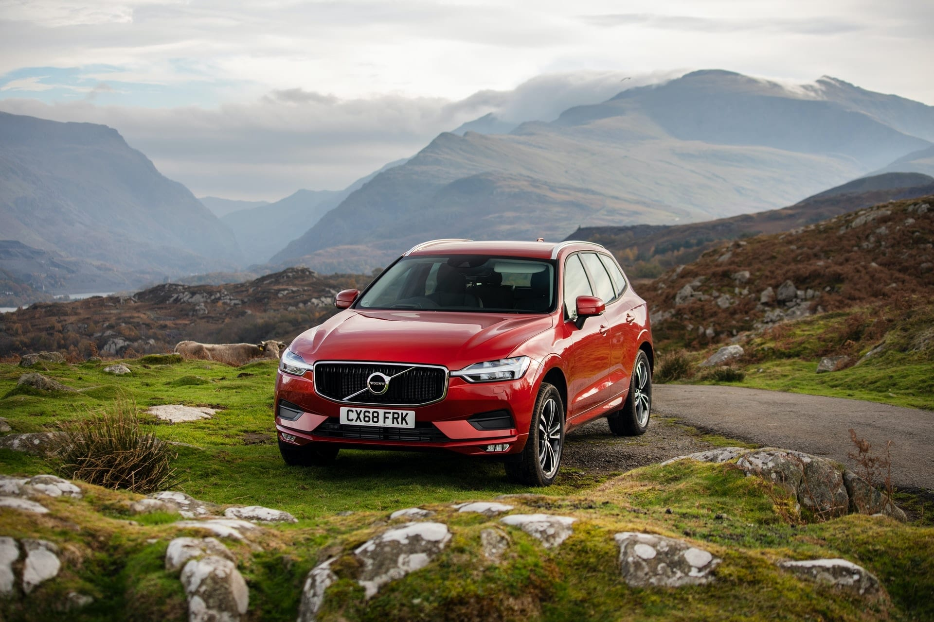 red-volvo-pulled-up-to-side-of-road-in-the-mountains-brecon-beacons-snowdonia-wales-best-scenic-drives-in-uk