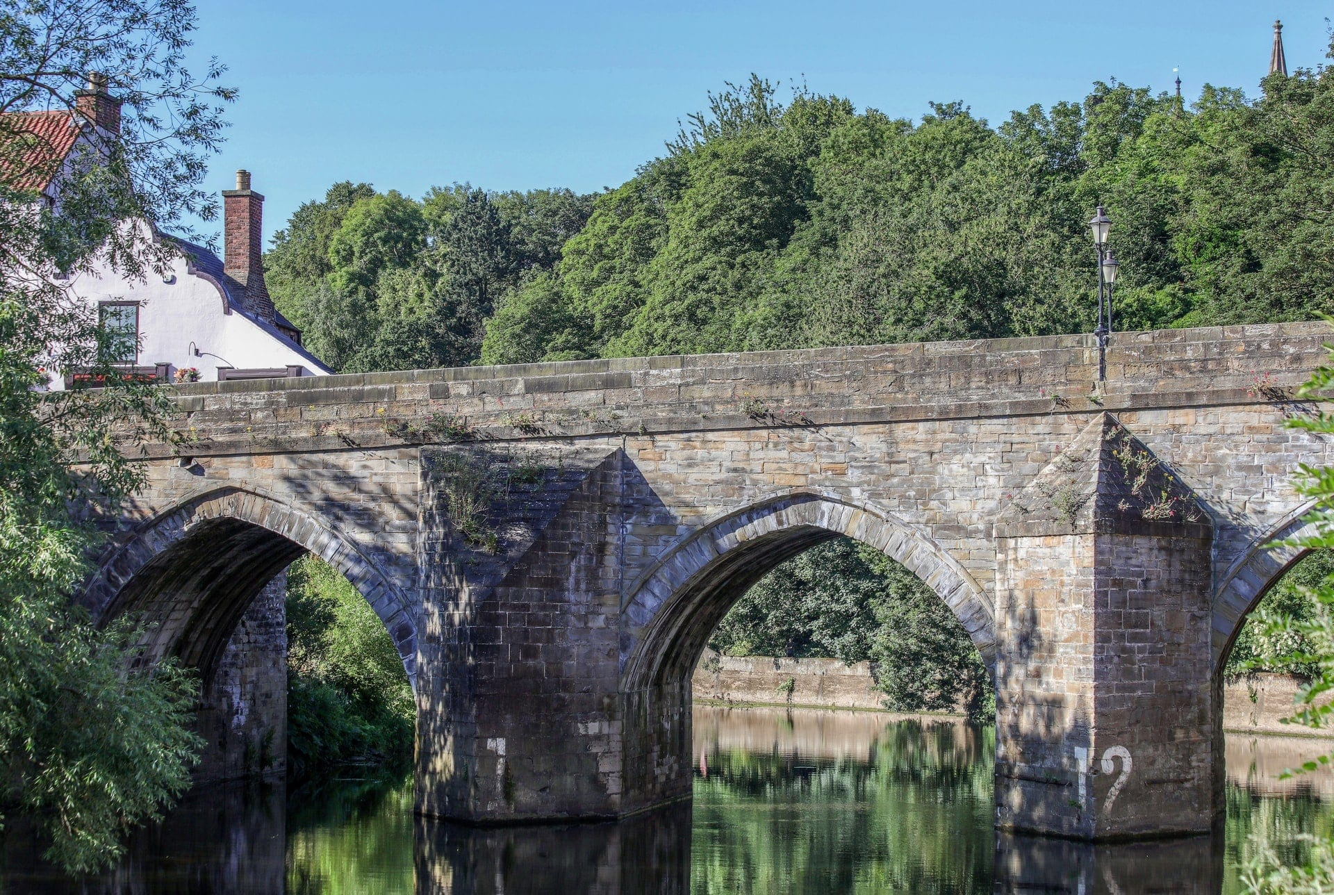 bridge-going-over-river-with-trees-in-background-in-durham