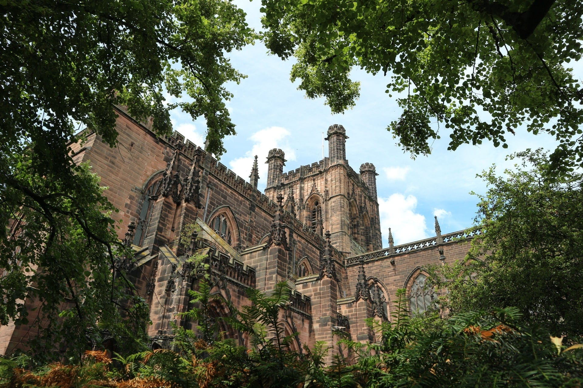 peeking-out-at-chester-cathedral-through-trees-greenery
