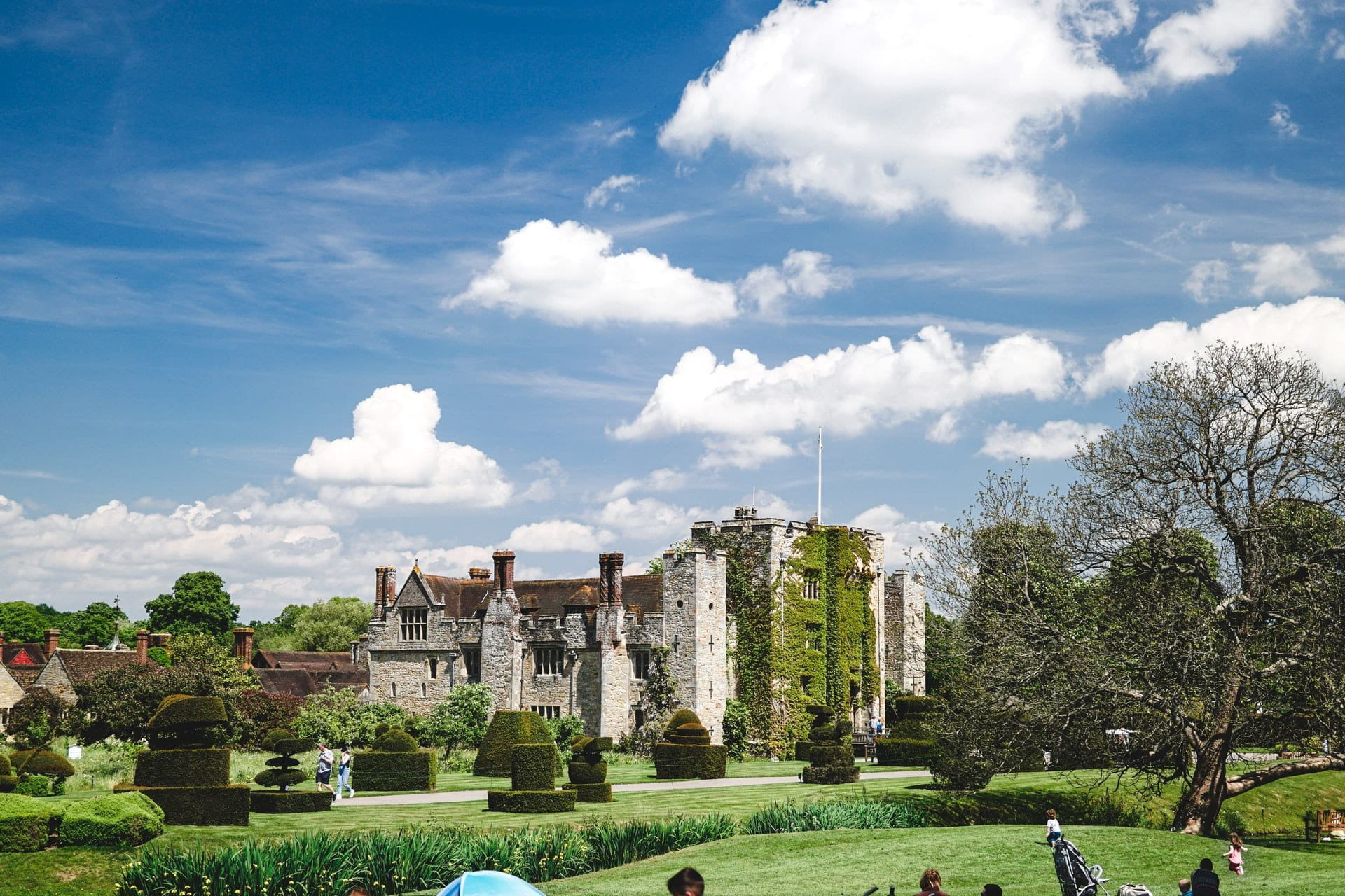 people-exploring-castle-on-summers-day-hever-castle-kent-day-trips-from-brighton