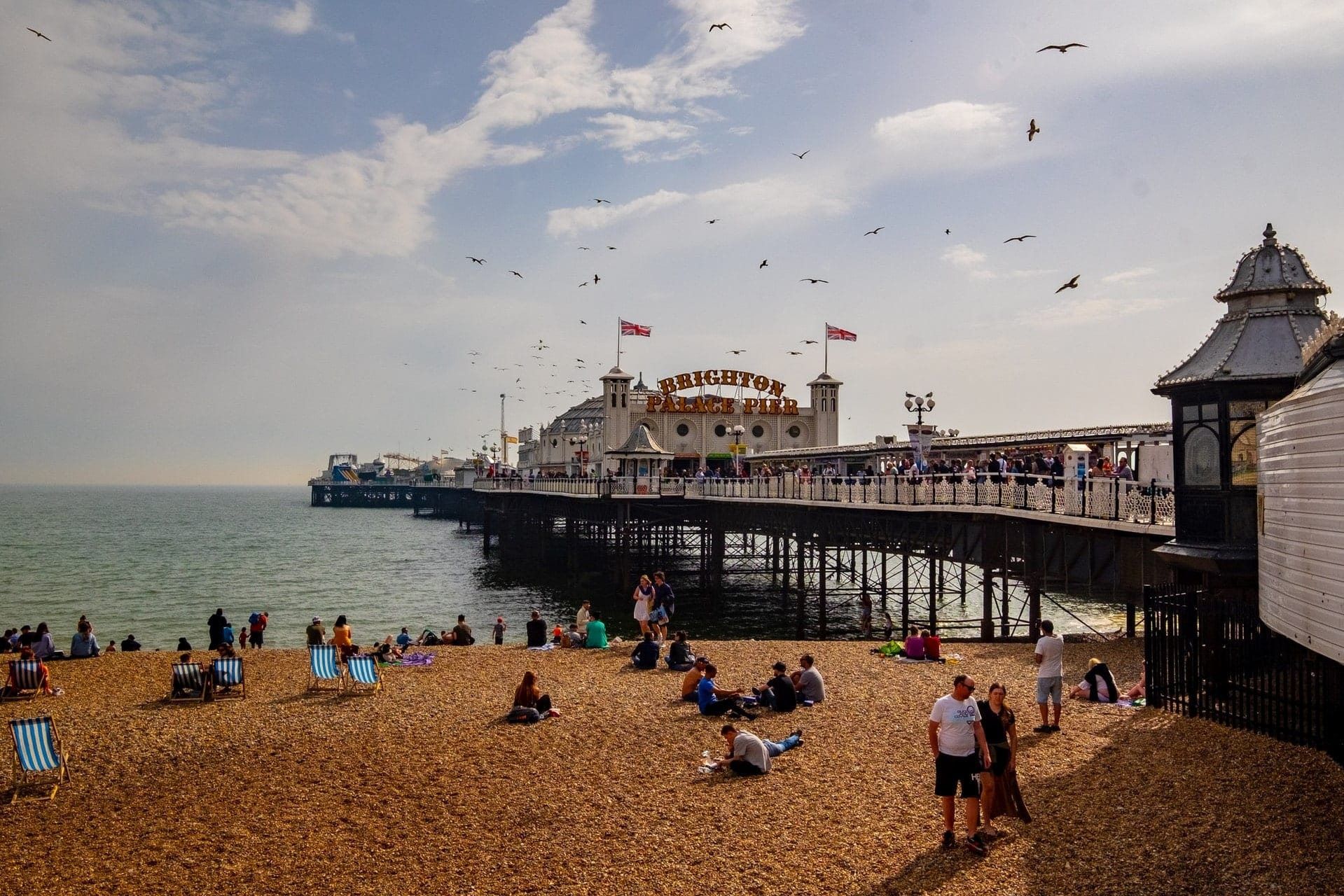 people-on-beach-by-pier-on-summers-day-brighton-day-trips-from-london-by-car