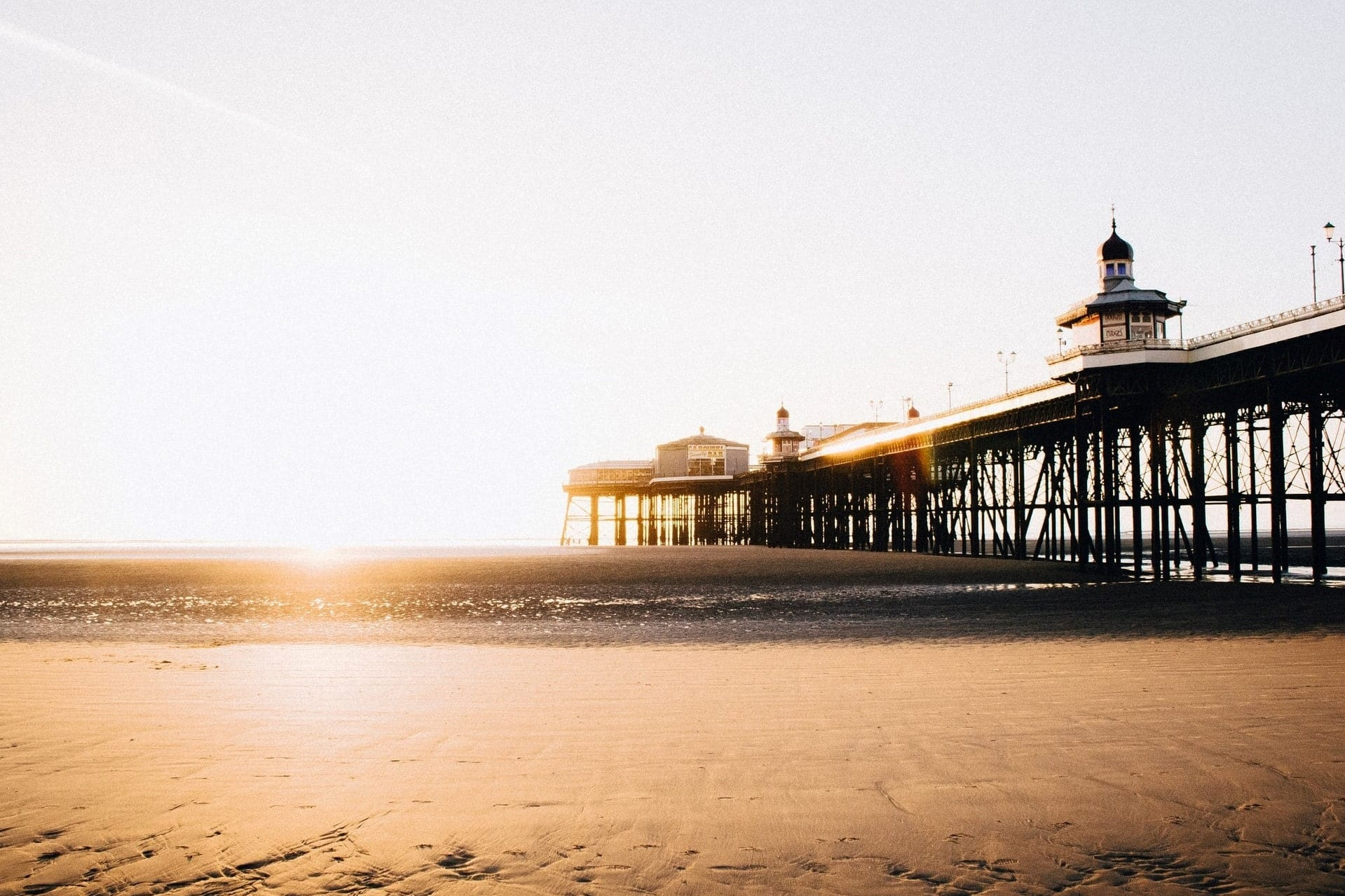 sandy-beach-and-pier-at-sunset-in-blackpool-day-trips-from-manchester